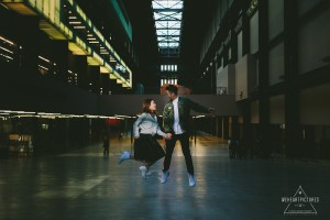 Couple Jumping in the Tate Modern, Alternative wedding photographer in London